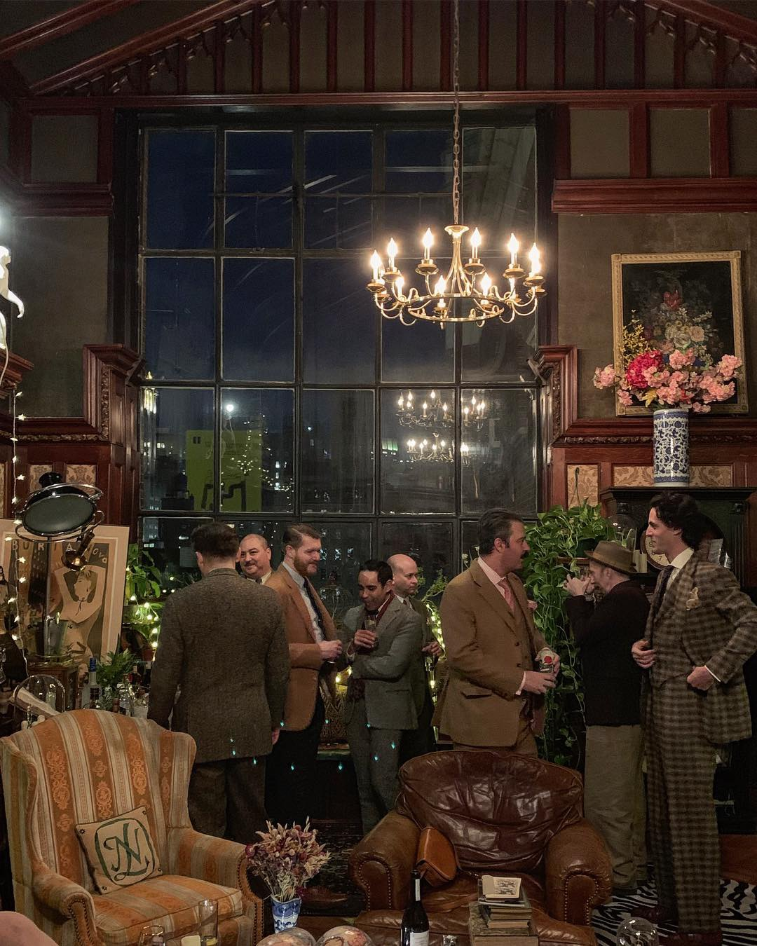 """The Tweed Talk afterparty, generously hosted by National Arts Club member and resident Nicholas Lowry. From Left to right, Andrew, Flusser clients Kelly Bray and Sean Crowley, Ralph Lauren's Basha Singh, Flusser client Don Spiro, Nicholas Lowry, unknown guest, and Flusser client Will Burghes in his Flusser MTM """"Dashing Tweeds"""" suit. (Photo by Rose Callahan)"""