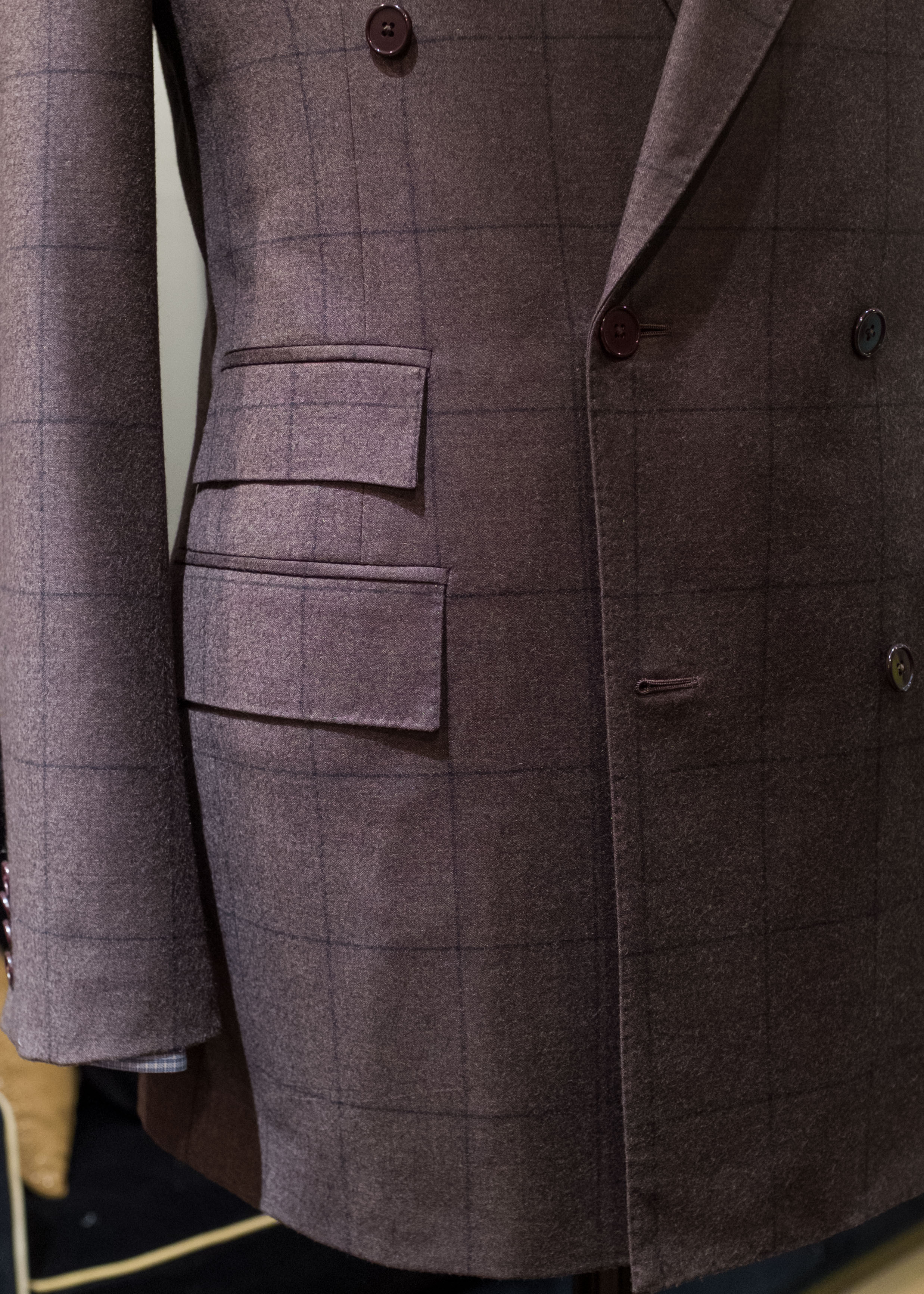 The sharp corners of these pocket flaps complement the squared front edges of this double-breasted suit jacket.