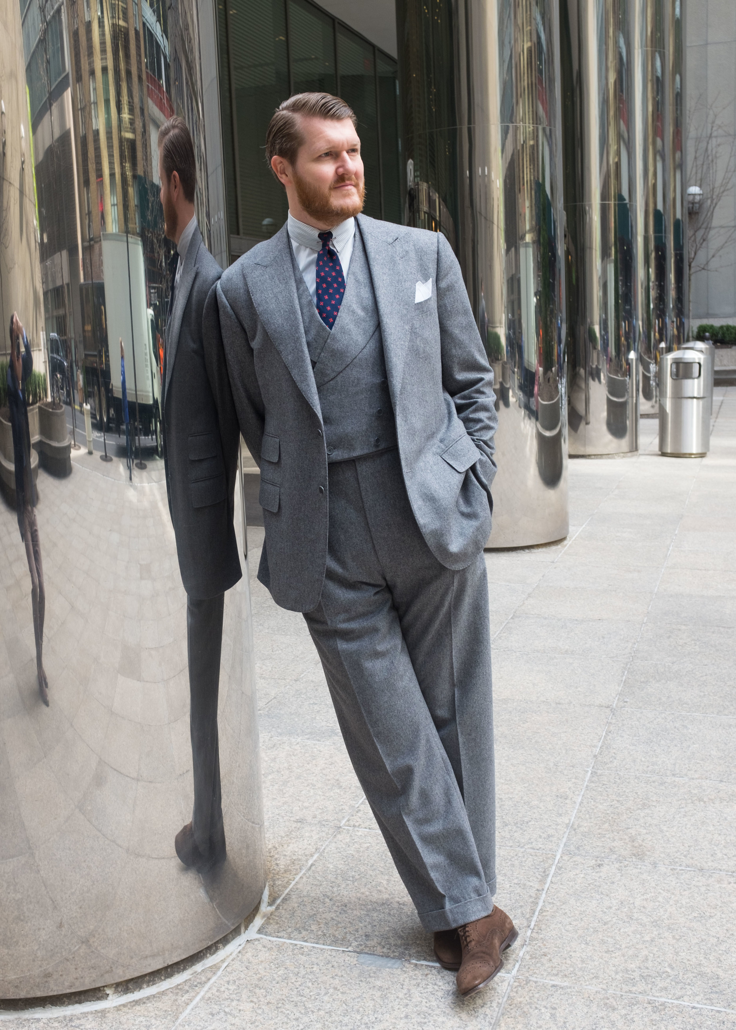 Crowley's made-to-measure suit and bespoke waistcoat from Alan Flusser Custom.