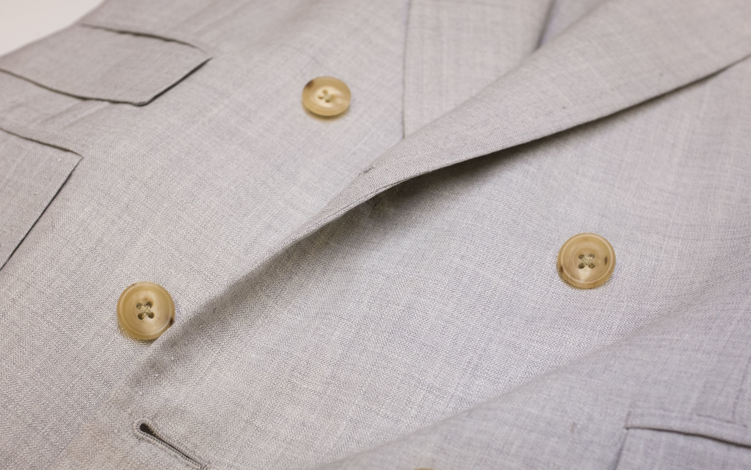 A Flusser Femme double-breasted suit jacket in light grey.