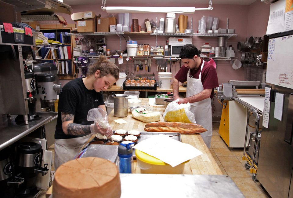 Sierra Henley, left, and Molhem Tayara, right, share counter space as they prepare baked goods.