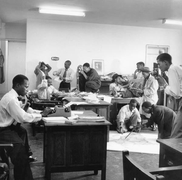 From left to right: Henry Nxumalo, Casey Motsisi, 'Zeke Mphahlele, CanThemba, Ntsipe, Arthur Maimane, Mtetwa, Xashimoa, Chocho, Dyantyi, Bob Gosani Photo:  Jurgen Schadeberg .