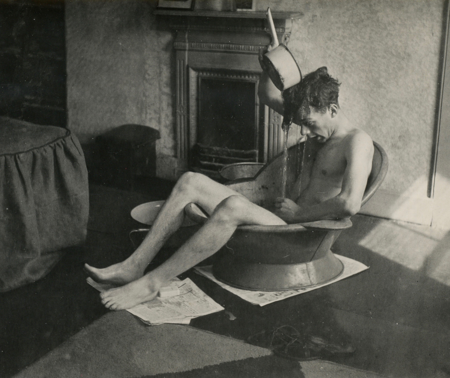 Sylvester having a bath in a New Compton Street tenement