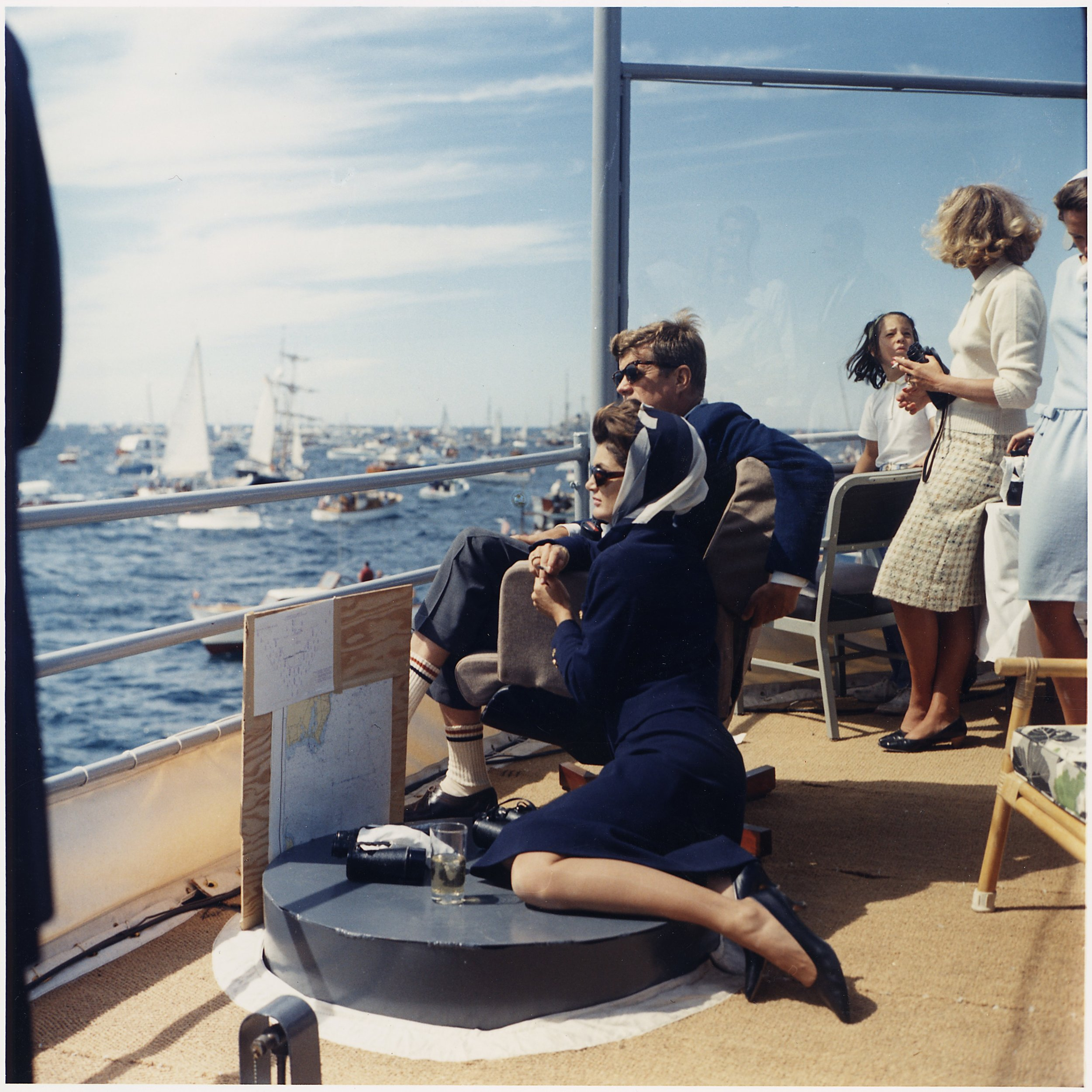 Watching_the_America's_Cup_Race._Mrs._Kennedy,_President_Kennedy,_others._Off_Newport,_RI,_aboard_the_USS_Joseph_P...._-_NARA_-_194214.jpg