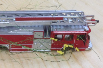 A fire truck with intricate wiring for its LED lighting system.