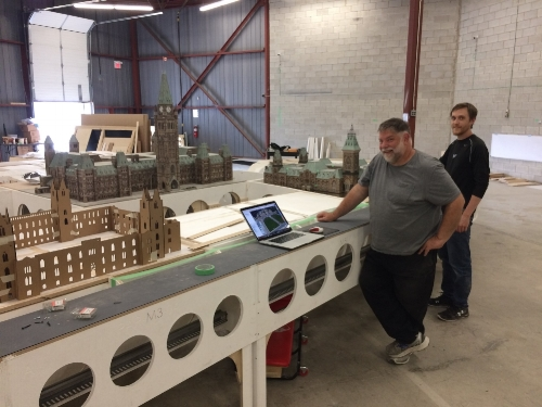Our Miniature Canada builders, Dan and Mark, admiring the site of our developing Parliament Hill