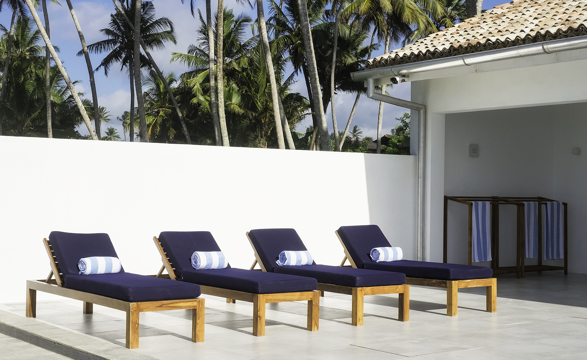Sun lounges by the pool (with umbrellas available)