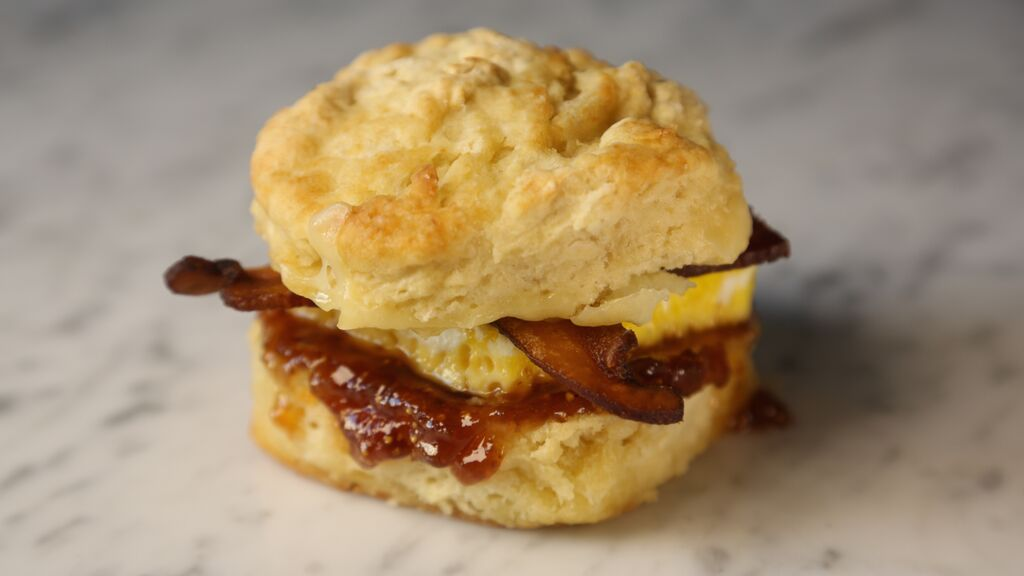Bacon egg and cheese biscuit sandwich with fig jam and sorghum butter