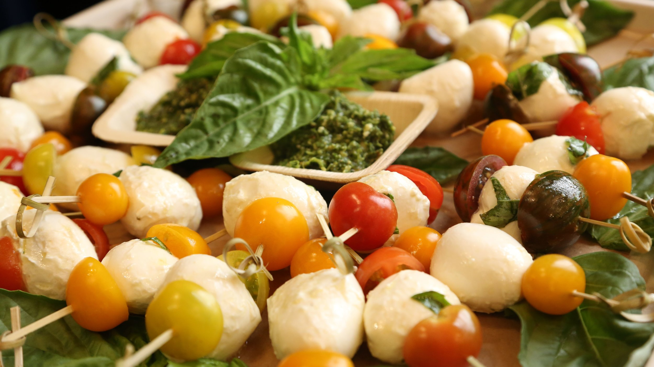 Caprese bite platter with pepita parsley pesto dip