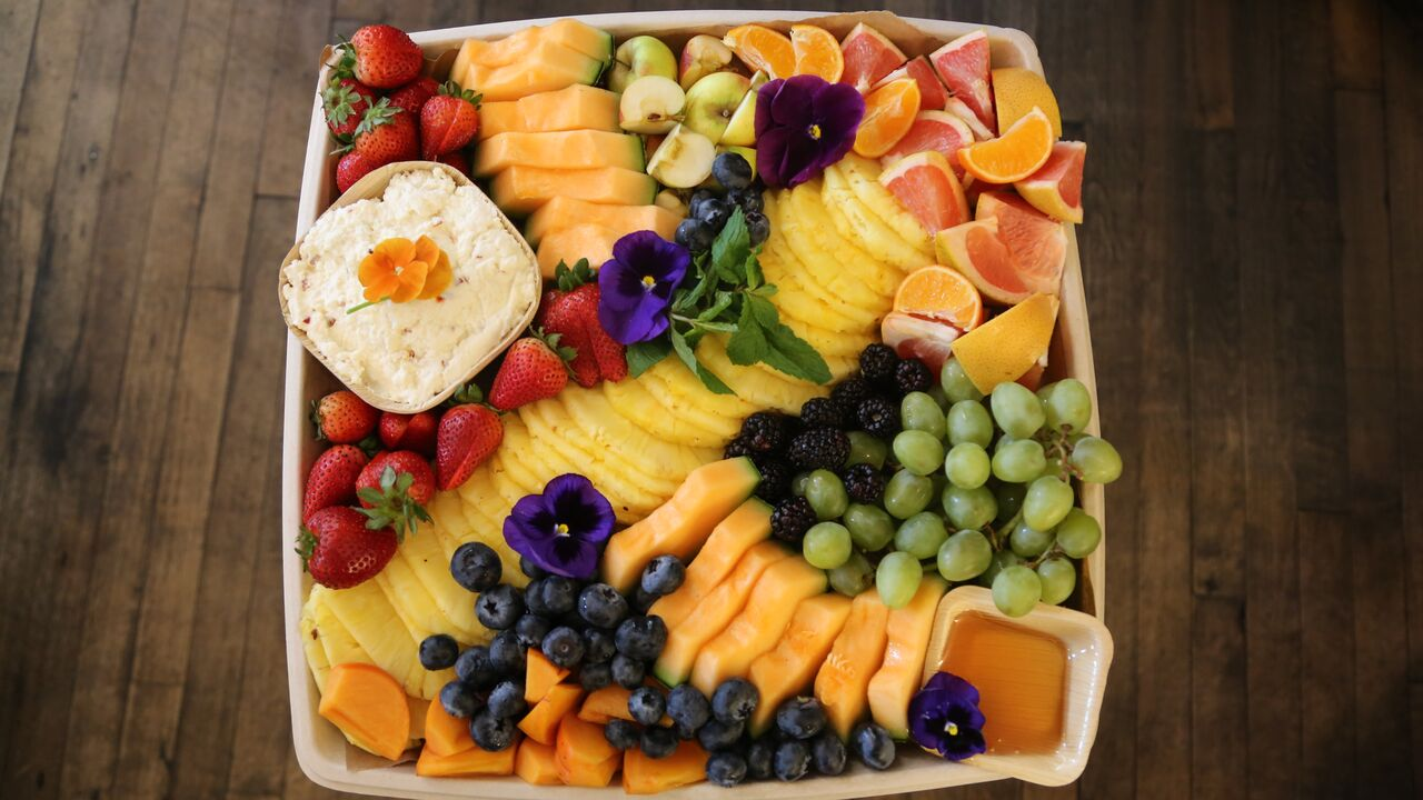 Large fruit platter with honey lemon ricotta dip