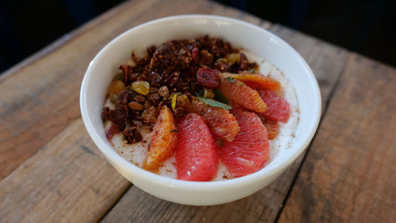 Yogurt parfait with five spice granola and citrus fruit
