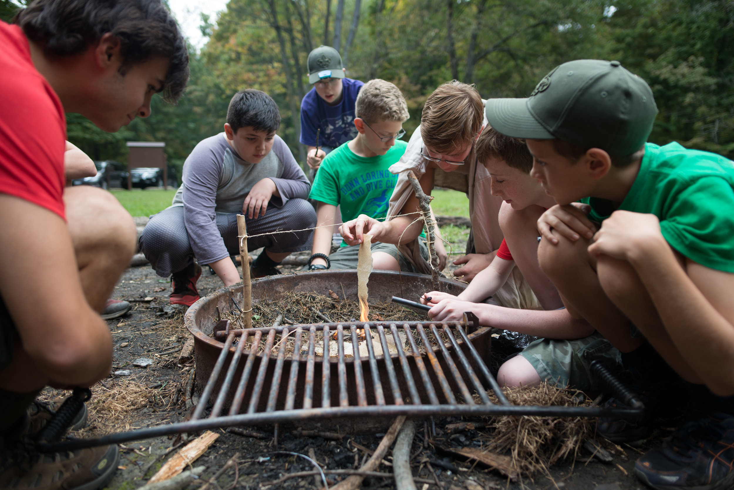 Lead by their patrol leader, Philip, first year scouts in BSA Troop 1978 scouts go head-to-head against older scouts in a fire-building competition.