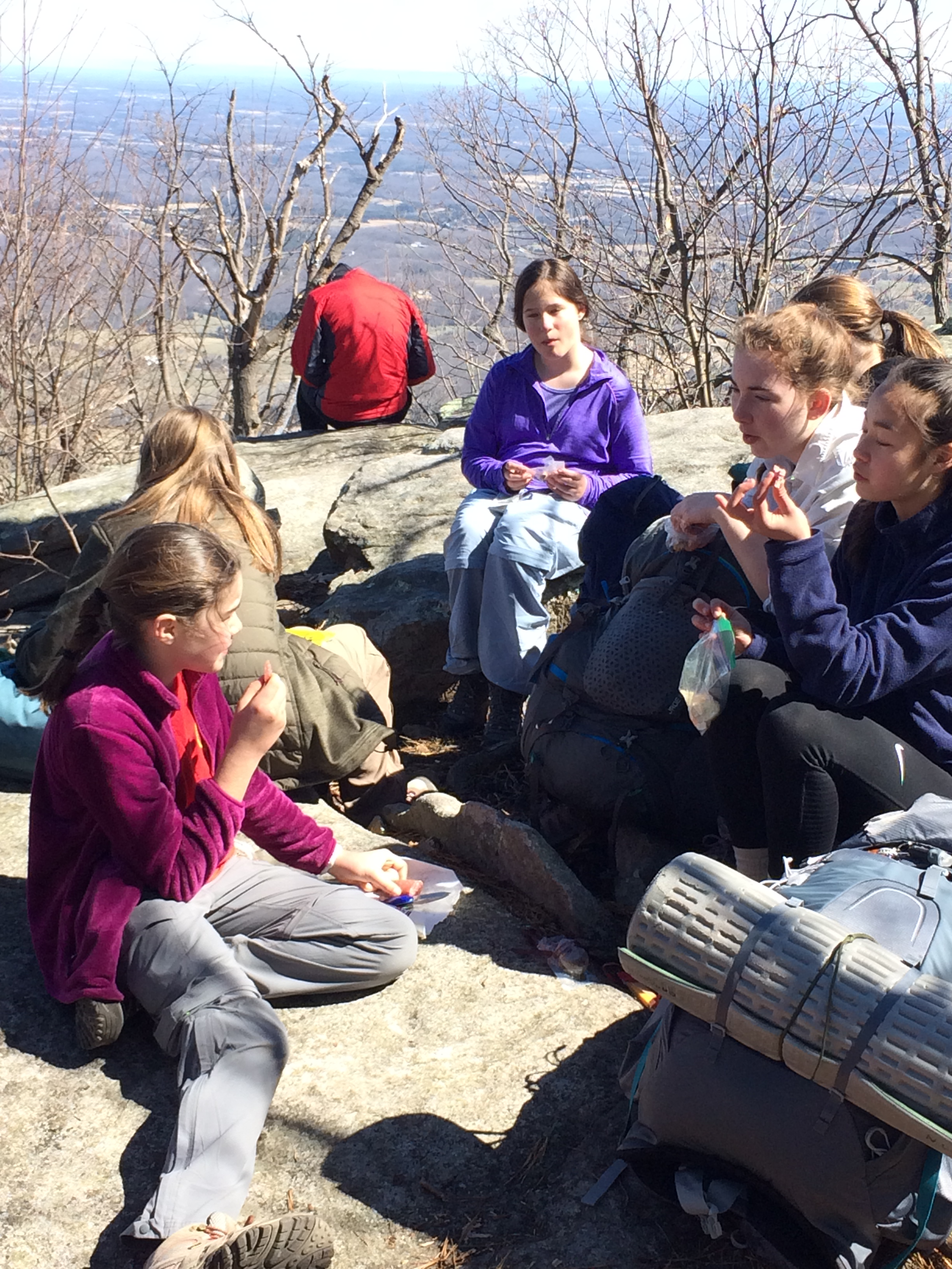Girls BSA enjoy lunch at the top of their first mountain hiked together, overlooking the farmland below at a place called Signal Knob.