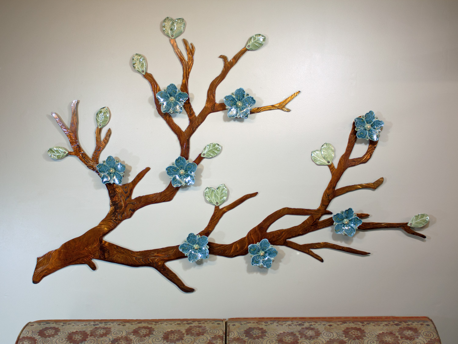 Signature flower design shown in Denim blue glaze with a Brown patinaed branch; approx. 6ft wide x 4ft tall