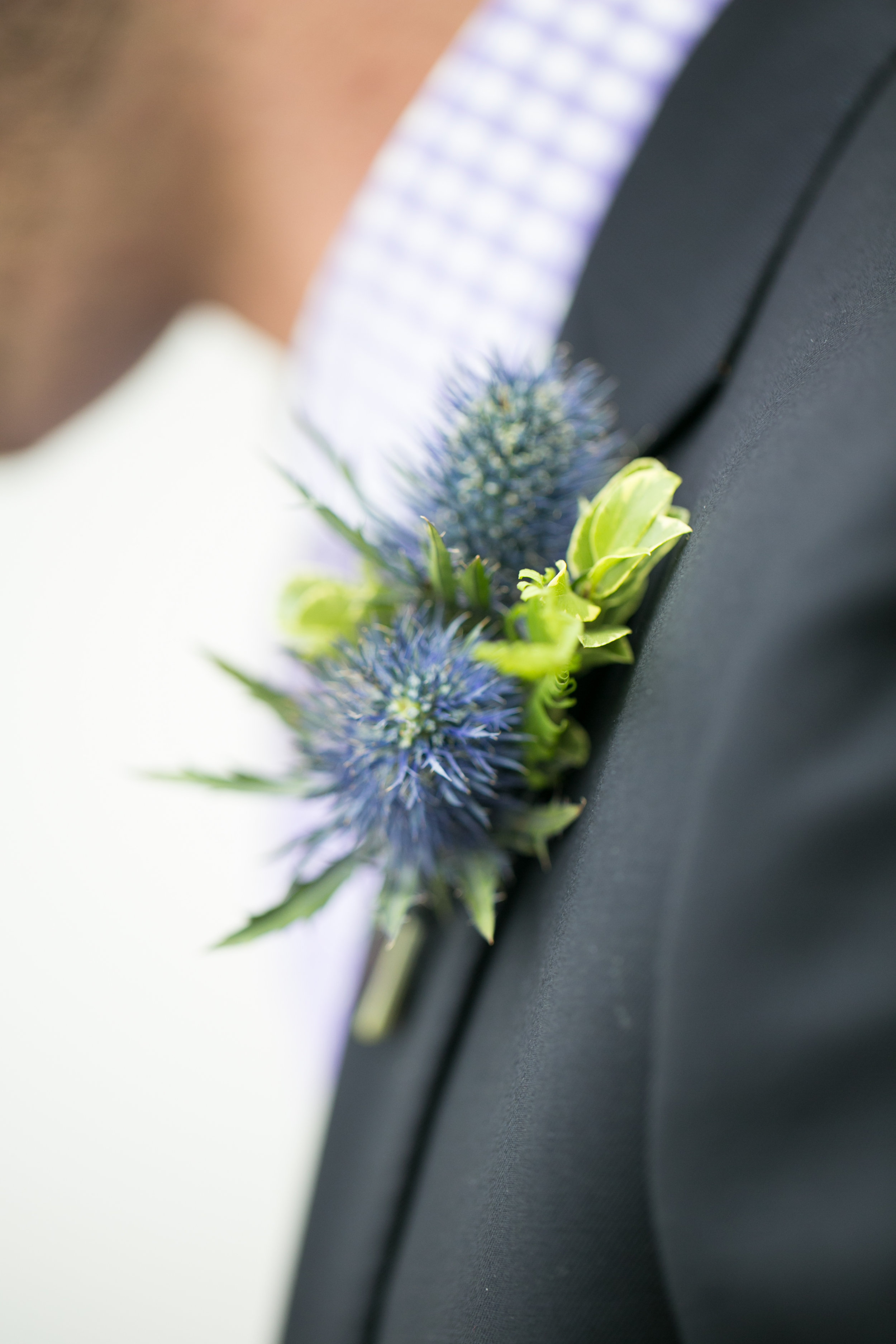 Blue thistle boutonniere