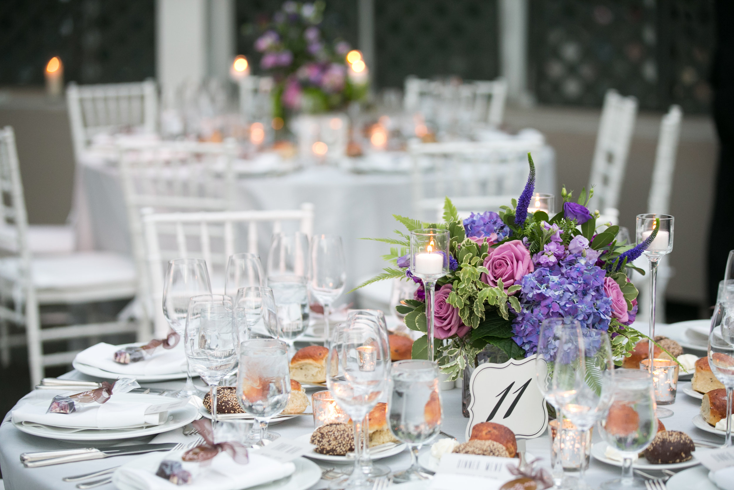 Purple centerpieces with candlelight
