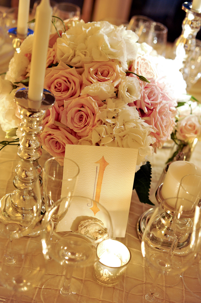 Pink and white centerpiece with candlelight