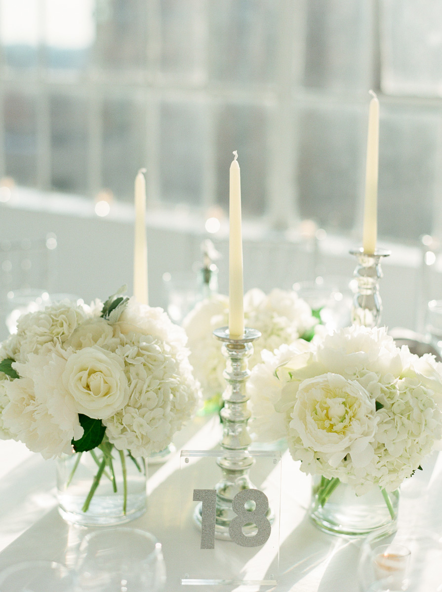 White flowers and silver taper candles