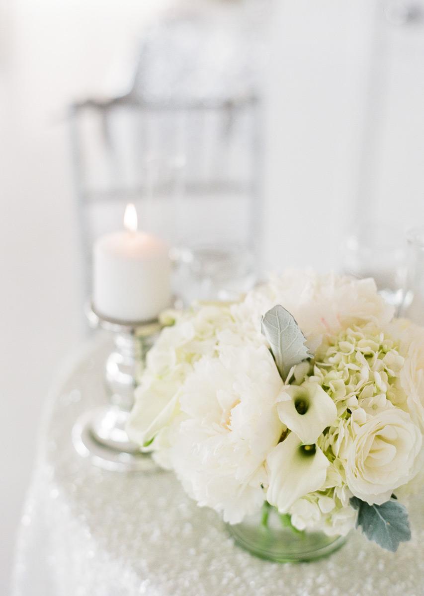 White flowers on white sequin linen