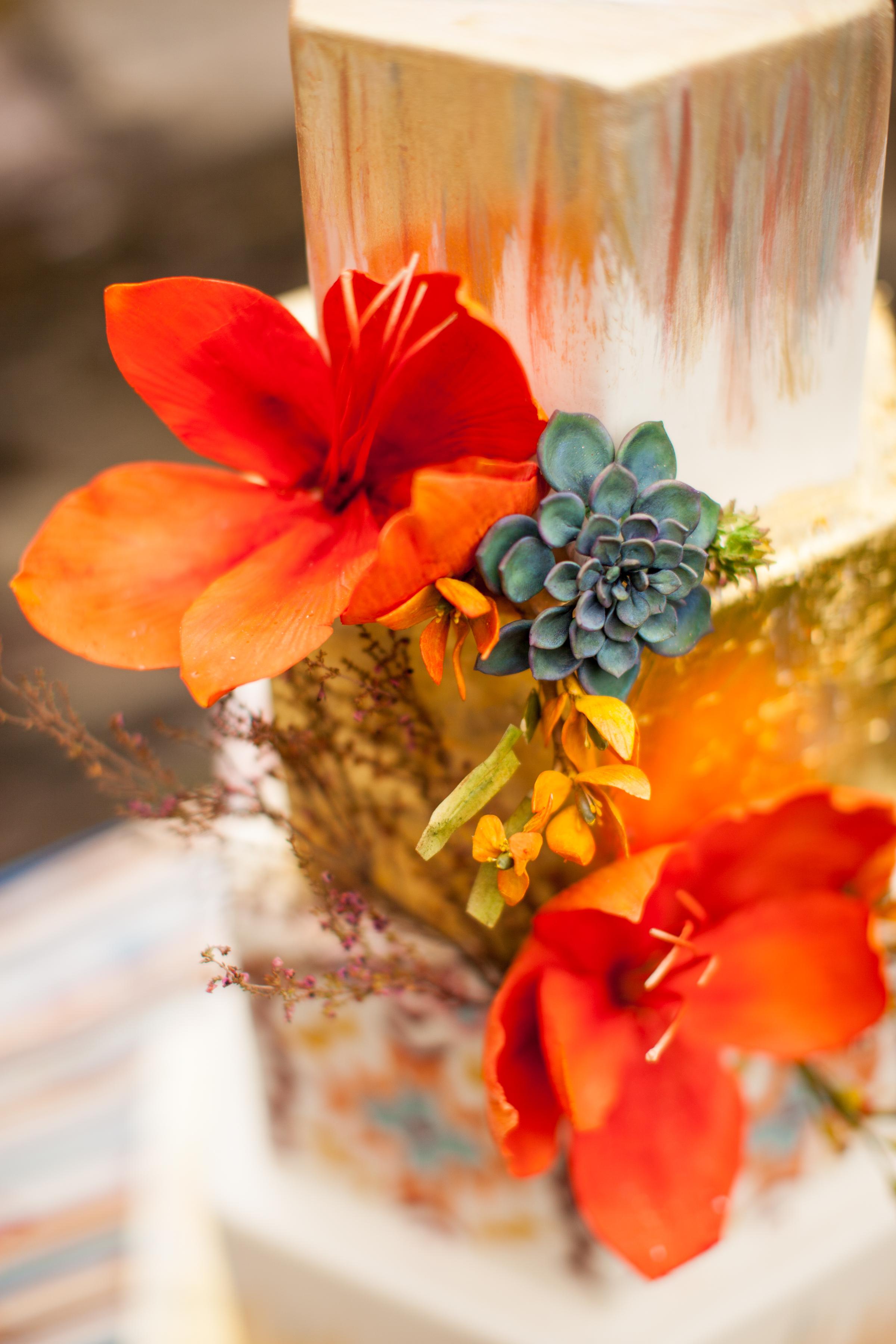 Orange sugar flowers and succulent cake