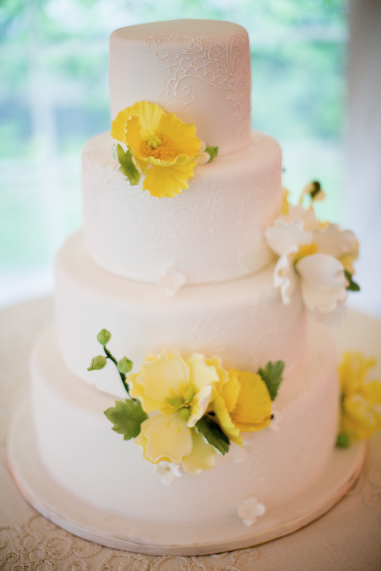 Yellow sugar flowers on cake