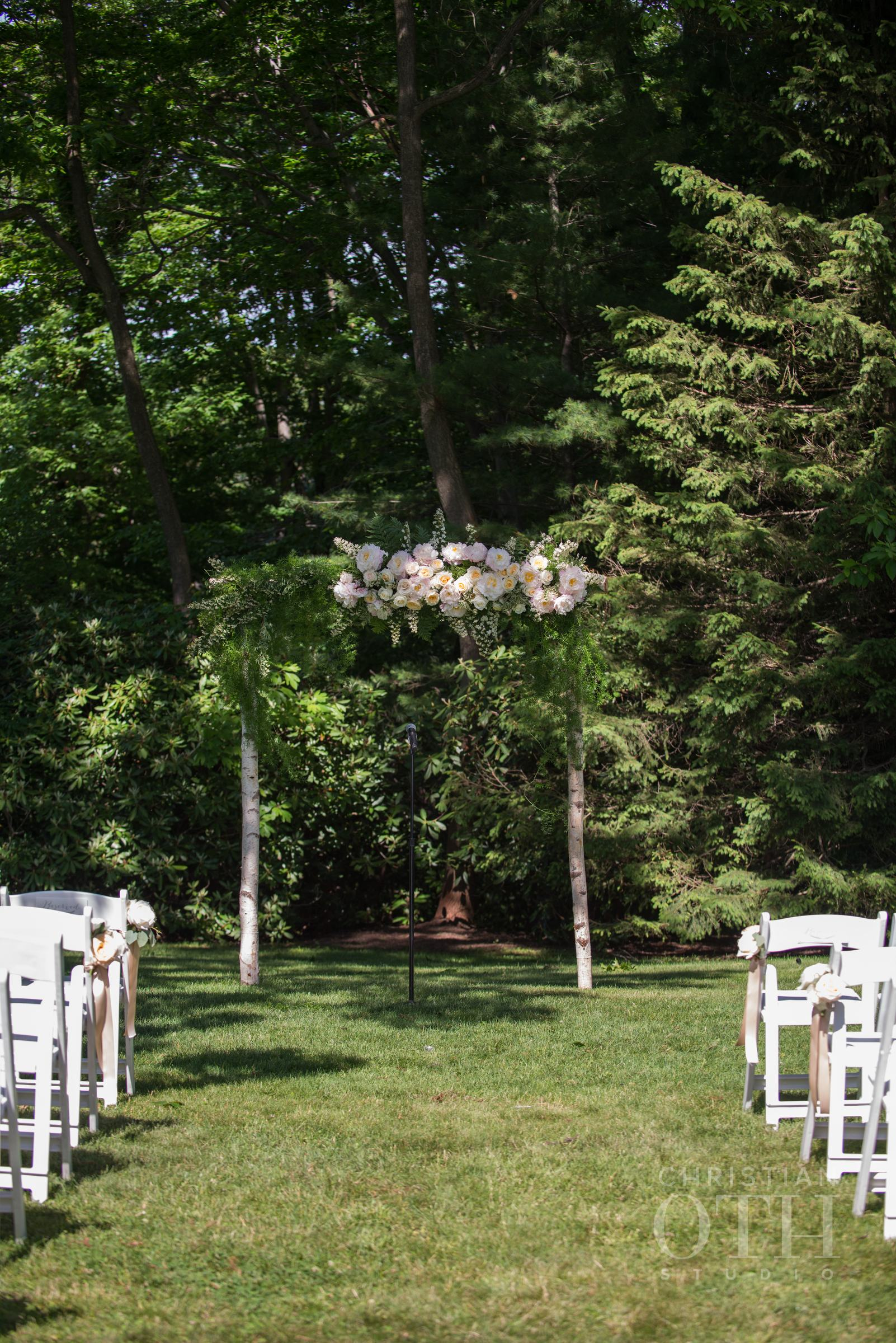 Ceremony backdrop with garden roses and greens