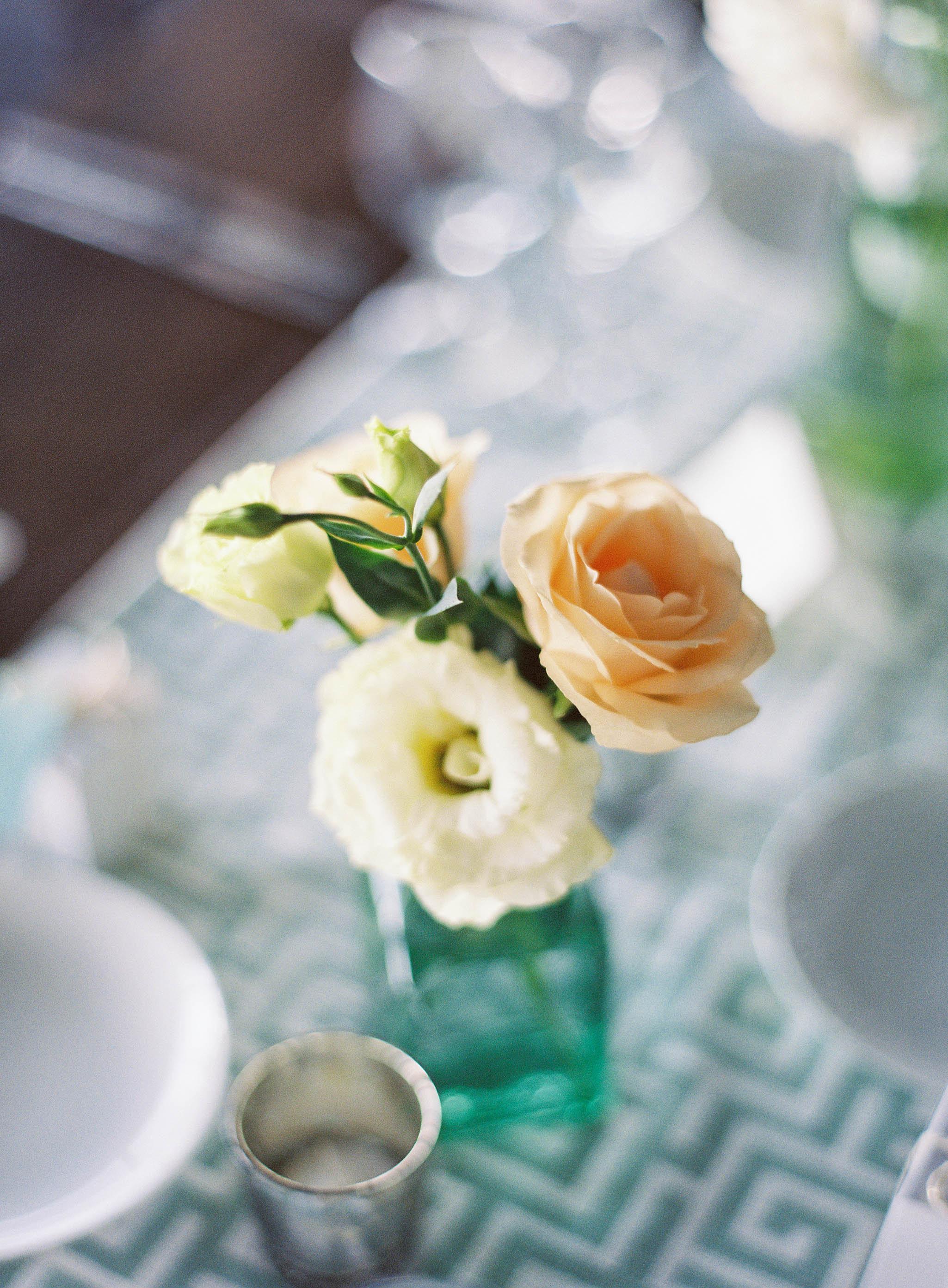 Green glass bottle bud vase