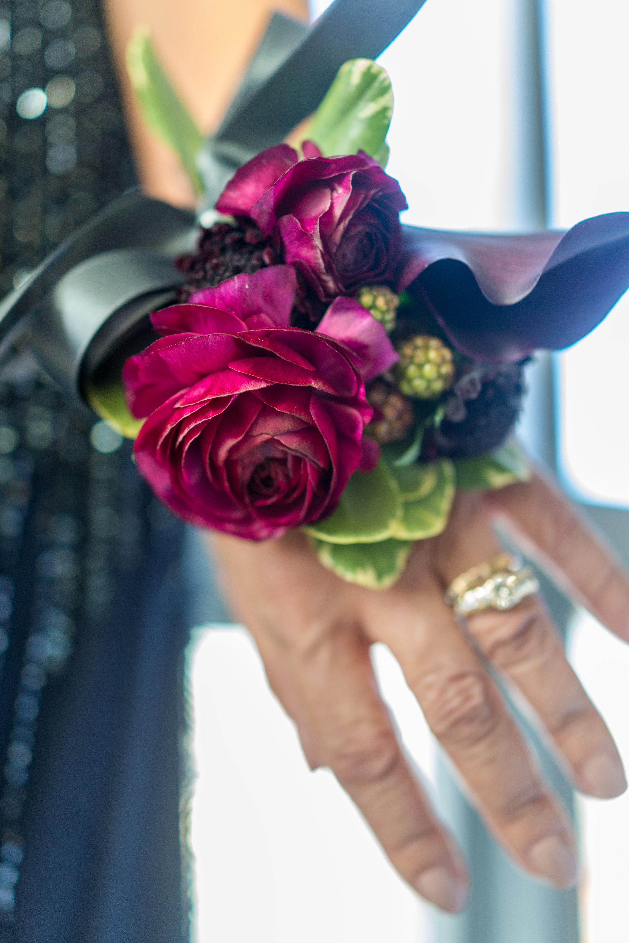 Ranunculus and black calla wrist corsage