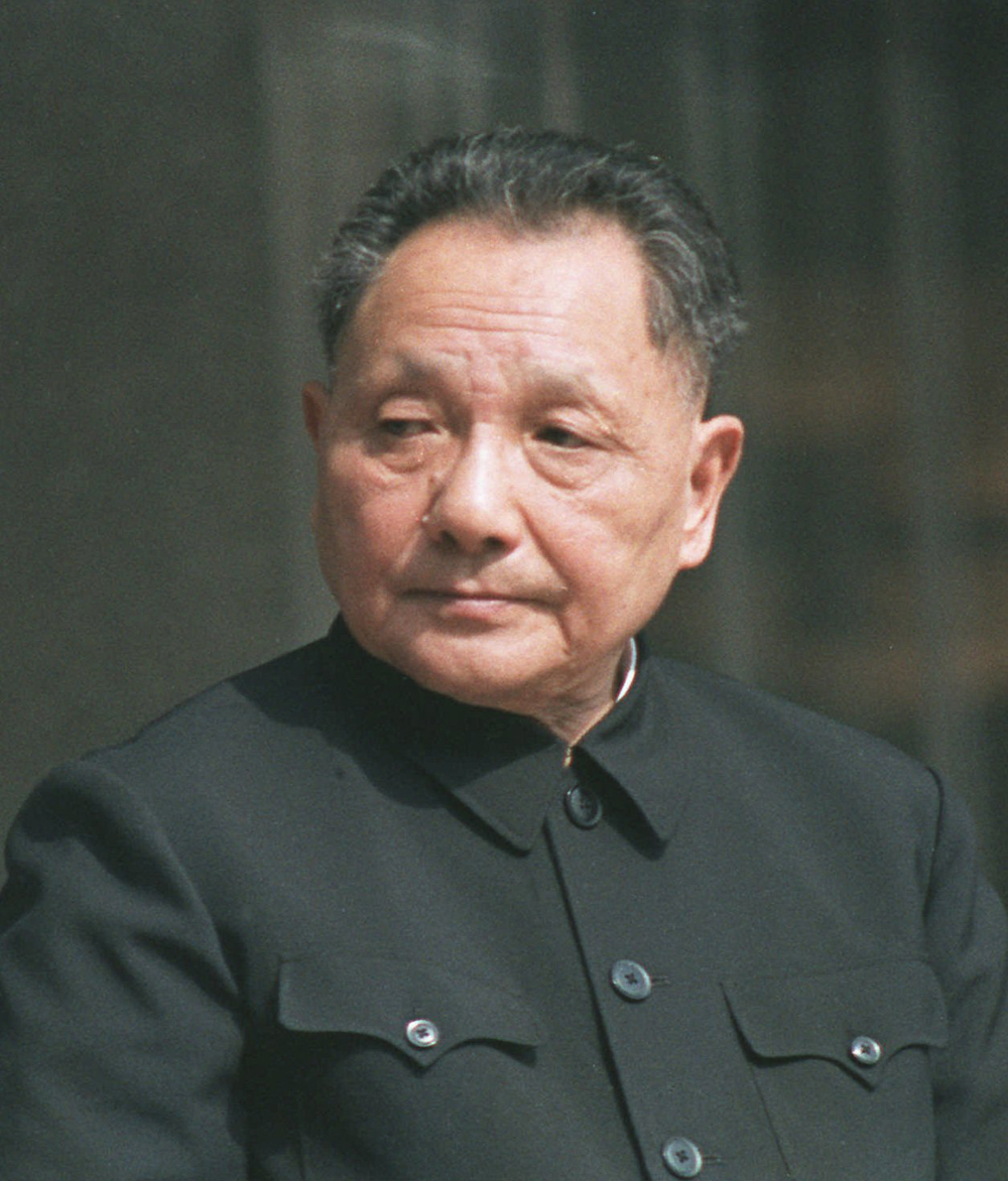 """China's leader  Deng Xiaoping  pronounce at the 14th National Communist Party Congress that China's plan for the decade was to create a """"socialist market economy."""""""
