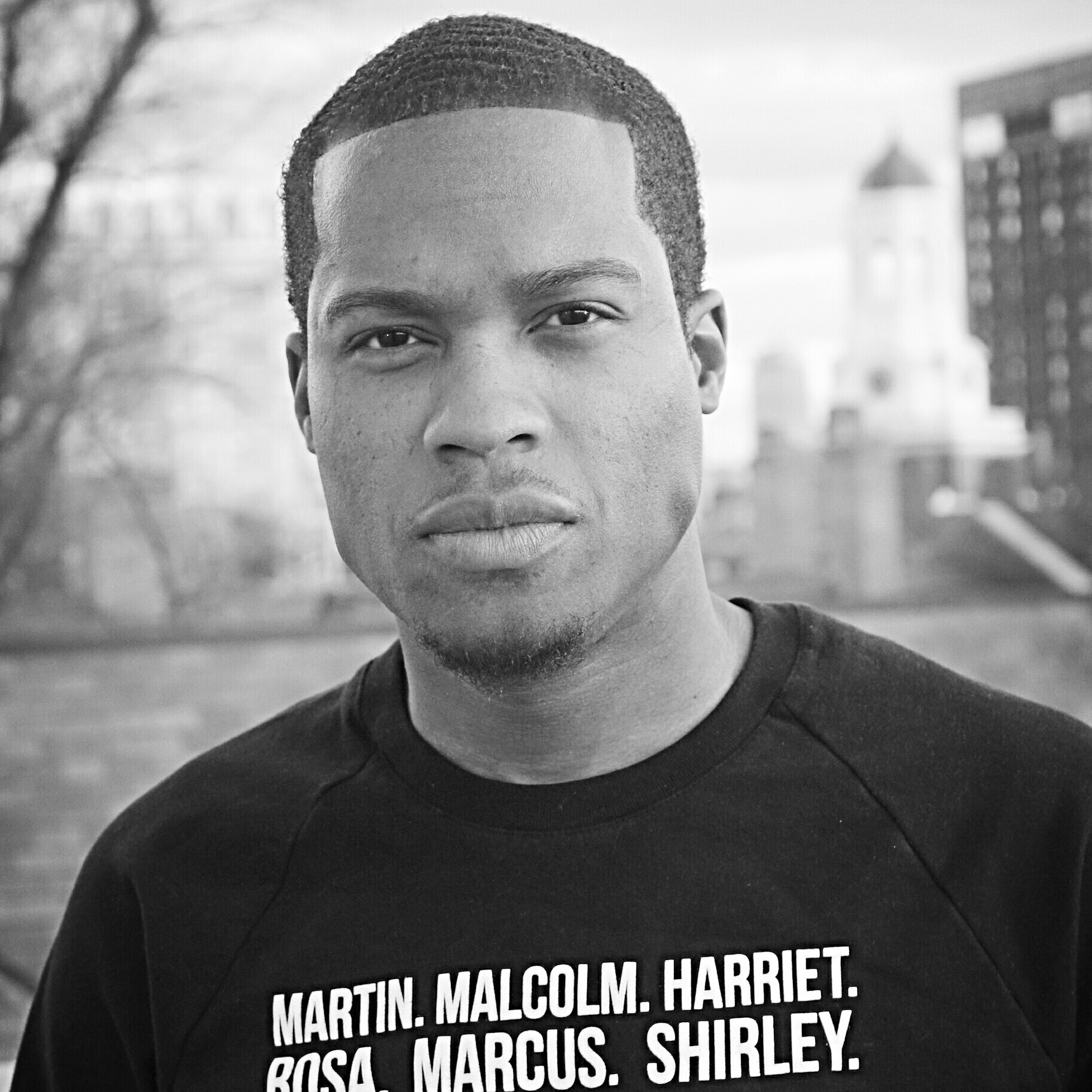 """Renaldo Pearson   Renaldo was born and raised in """"The DMV"""" (Washington, DC and Fort Washington, MD) and serves as Co-Mission Director of Democracy Spring. In his speech at the inaugural Unrig the System Summit in 2018, the 50th anniversary year of Dr. King's assassination, Pearson resurrected Dr. King's undelivered sermon, """"Why America May Go to Hell,"""" and boldly juxtaposed it to his new framework for the democracy movement, """"The 7 Deadly Sins of American Democracy."""" Global think tank and government corruption watchdog Transparency International has since credited that speech and framework for becoming """"a touchstone for thousands of anti-corruption and pro-democracy activists around the country.""""  Three years after our historic April 2016 mobilizing launch where we demanded that Congress #FixDemocracyFirst, he stood behind congressional leadership (at the invitation of the Speaker of the House) for the pre-vote press conference and watched from the House Gallery during their vote to pass H.R.1, The For the People Act — a historic milestone (advancing virtually all of the pro-democracy countermeasures to """"The 7 Deadly Sins of American Democracy"""") which might not have been possible without the thousands that mobilized for and since Democracy Spring.  Pearson is a 2011 graduate of Morehouse College and former Harvard University administrator and Social Engineer-in-Residence. He co-founded the Boston Democracy Circle (a heart and brain trust for local champions of democracy) with Frances Moore Lappé, helped to inspire the new support ecosystem for """"Democracy Entrepreneurs"""" as a founding consultant, and now serves on the boards of Voter Choice Massachusetts (advancing ranked-choice voting) and Free Speech TV. He is featured in award-winning filmmaker Josh Tickell's new book and film,  The Revolution Generation: How Millennials Can Save America and the World (Before It's Too Late)."""