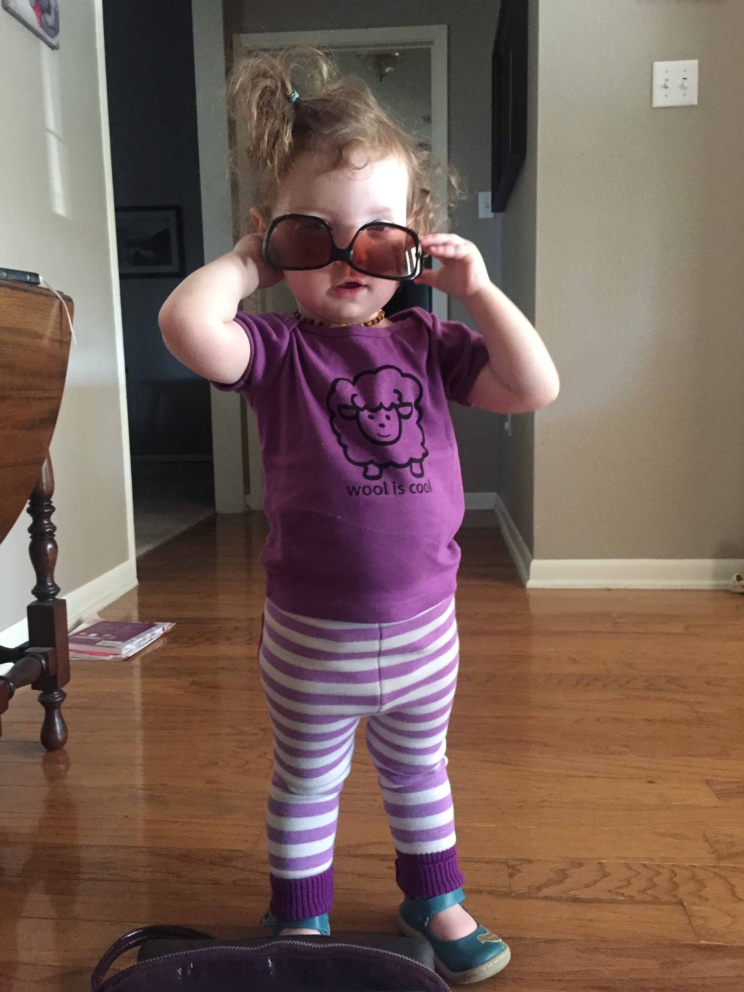 - And since I know most of you are here to see Cora, here she is again channeling Elton John in her awesome new Sloomb Gold woolies!