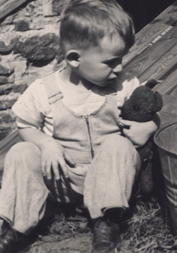 Teddy, in my arms as a child in Webster.