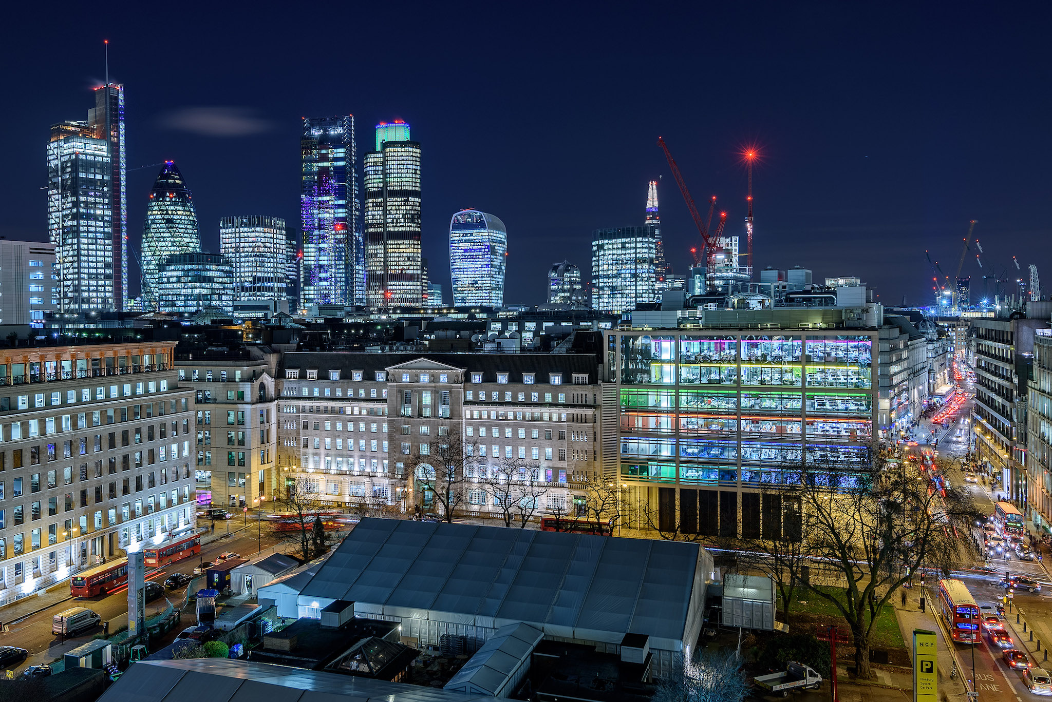 Skyline of the City of London at night.