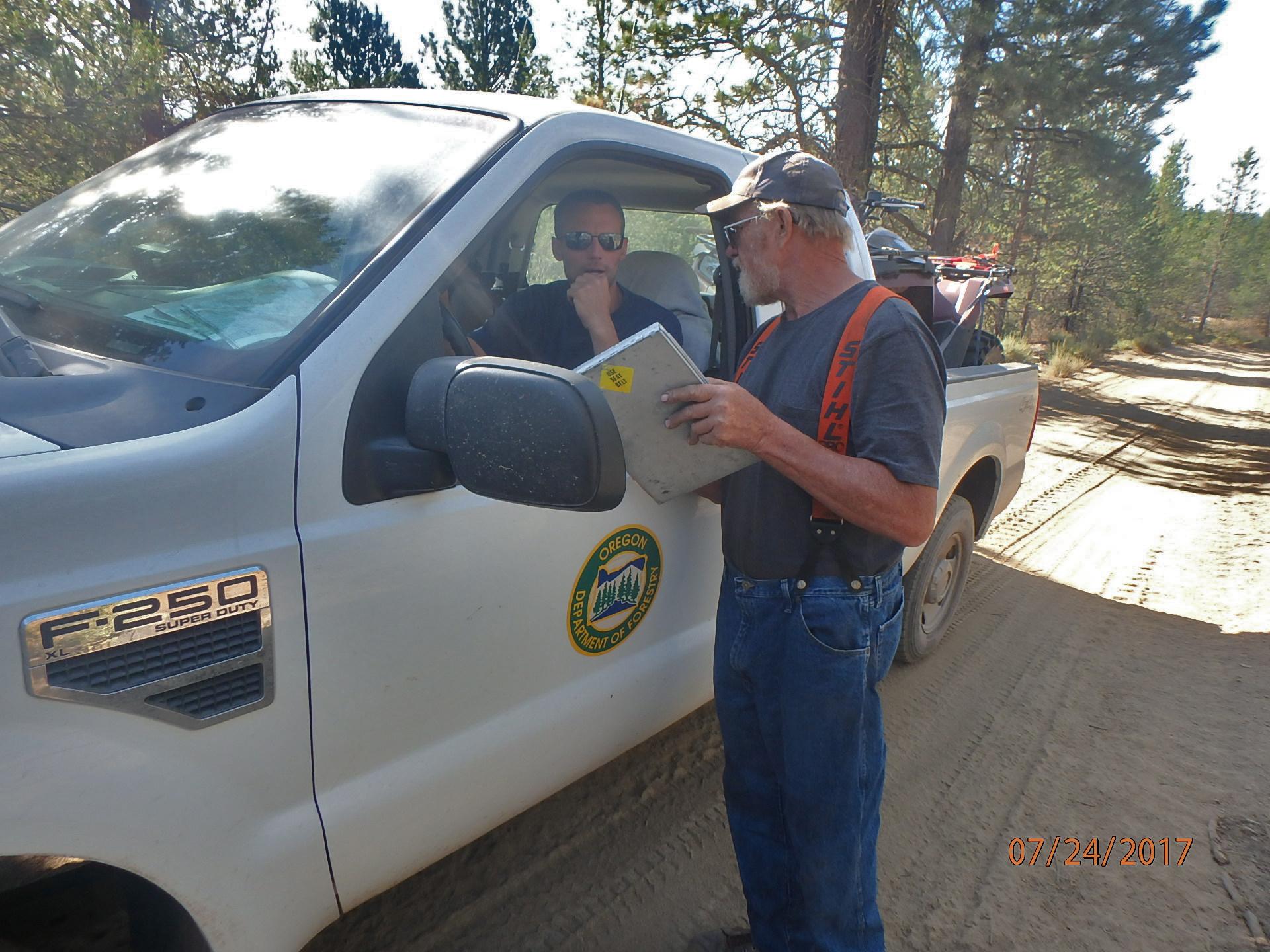 ODF Stewardship Forester Jason Pettigrew discusses treatment prescriptions with a logging contractor