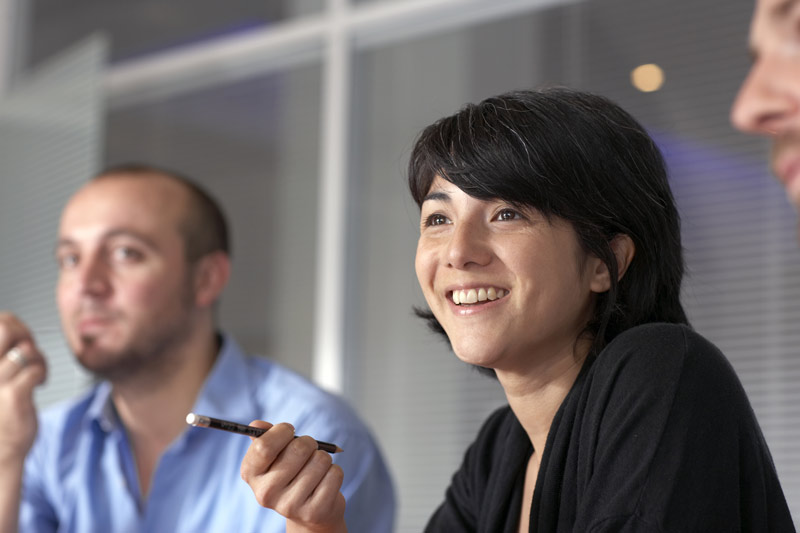 Happy woman speaking during a business meeting.