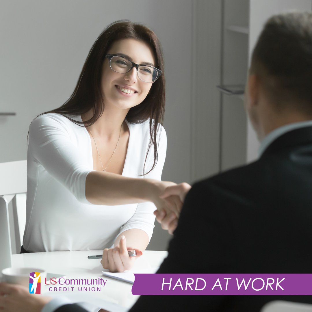 Woman shaking hands at a job interview