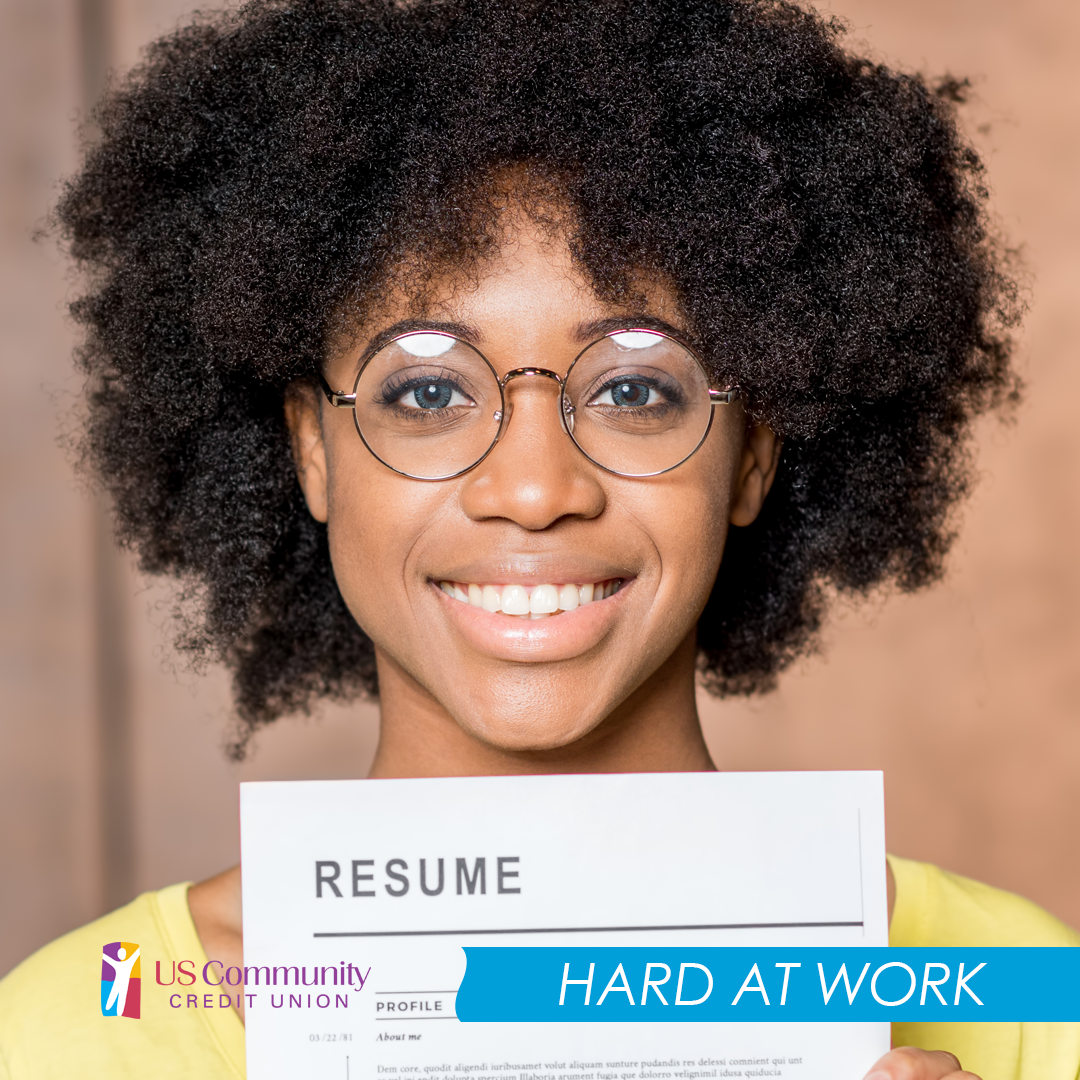 A smiling woman with glasses holding a resume