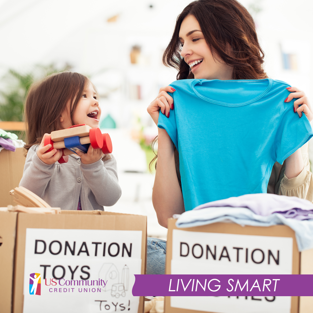 A mother change child adding toys and clothes to a donation box
