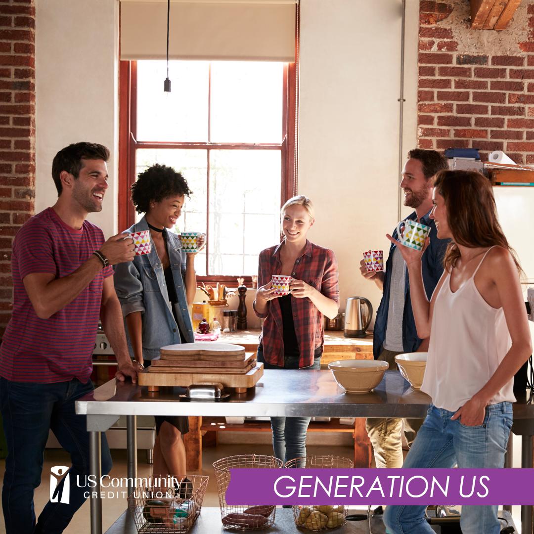 A group of millennials enjoying coffee around a kitchen counter.