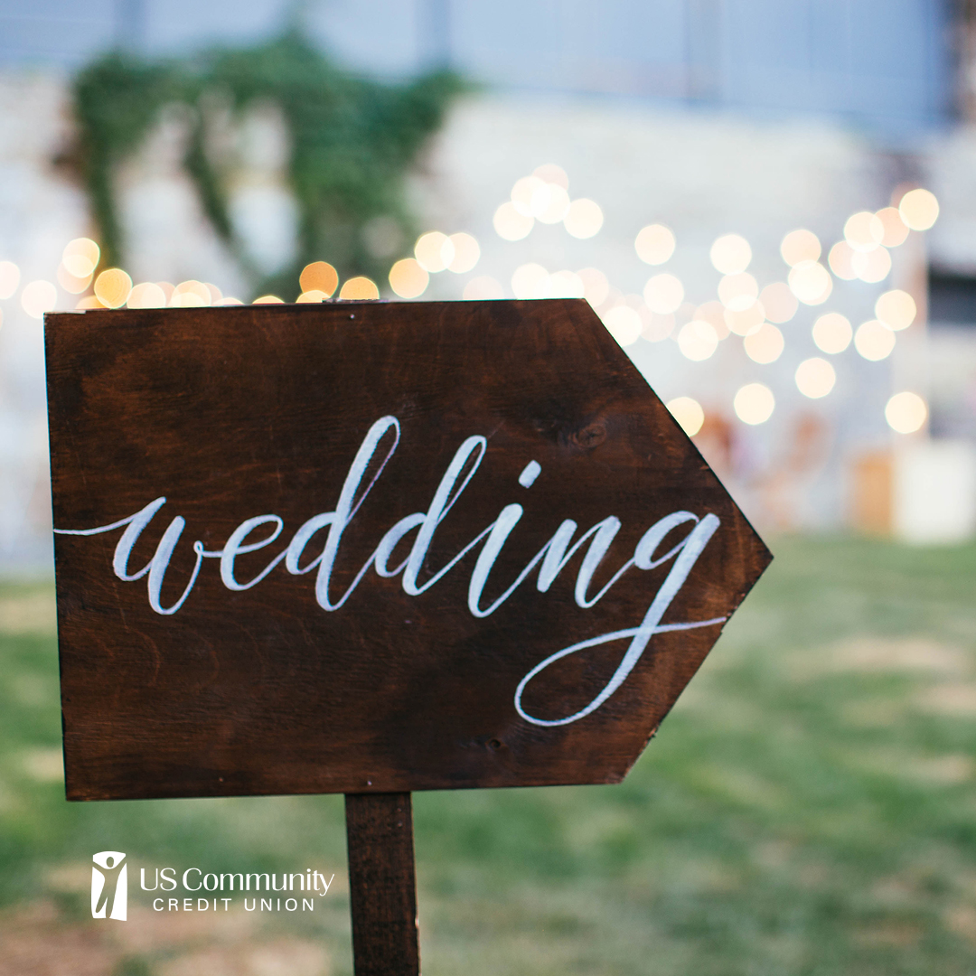 """Wedding"" written on a sign, pointing to the right"