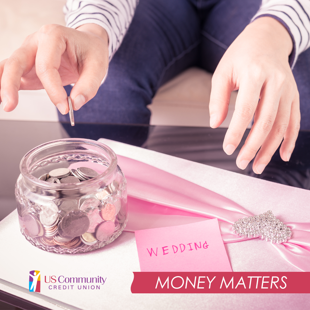 Hand putting a coin in a coin jar with a sticky note next to it that says wedding.
