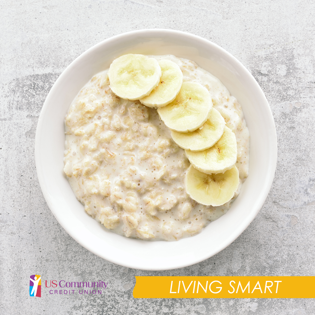 Bowl of oatmeal with sliced banana in it.