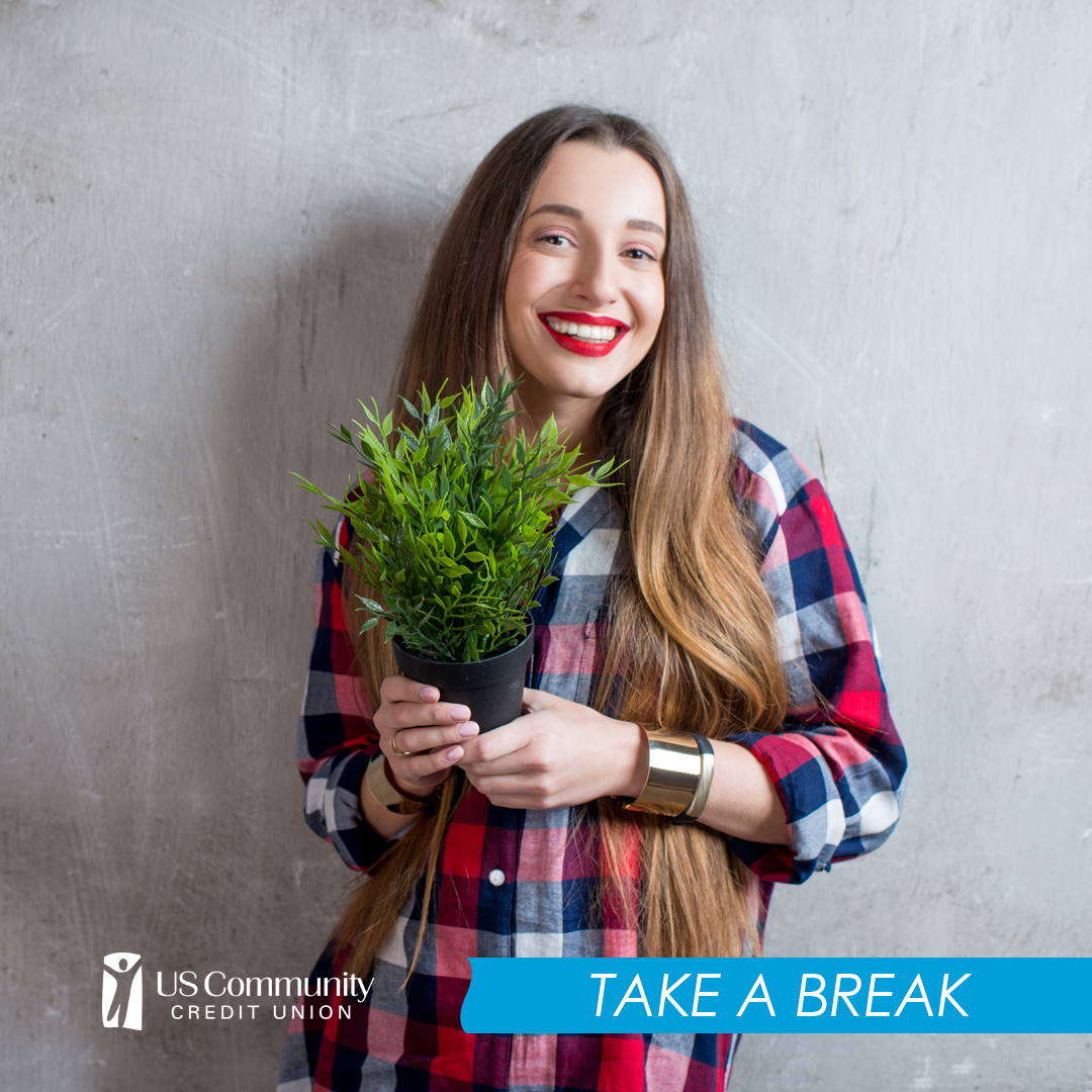 Woman holding a plant.