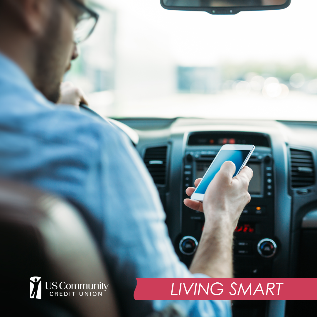 A distracted driver looking at phone while driving car, not obeying new Hands-Free Tennessee law which went into effect July 1, 2019.