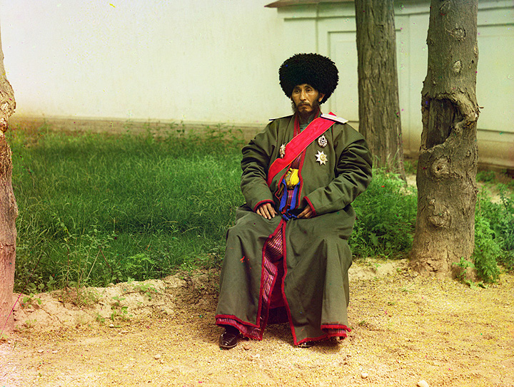Isfandiyar, Khan of the Russian protectorate of Khorezm (Khiva). In uniform, seated on chair, outdoors. 1910-1915.