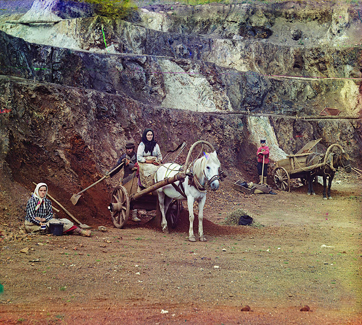 Work at the Bakalskii mine. A family, with shovels and horse-drawn carts, working at the iron mines in the Bakaly hills. Russia, 1910.