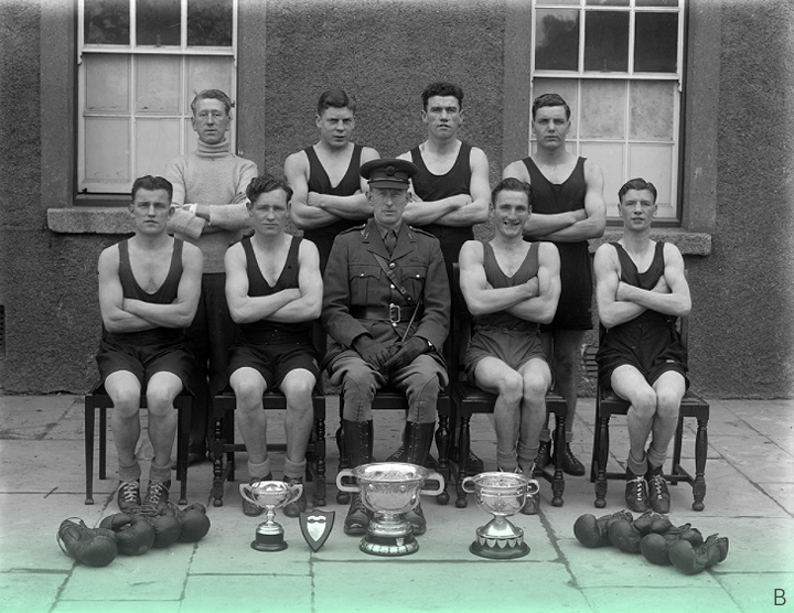 March 10, 1944 // Award winning army boxing team at the Barracks in Waterford, complete with their silverware. Would assume that the chap at the back in the polo neck was their trainer.