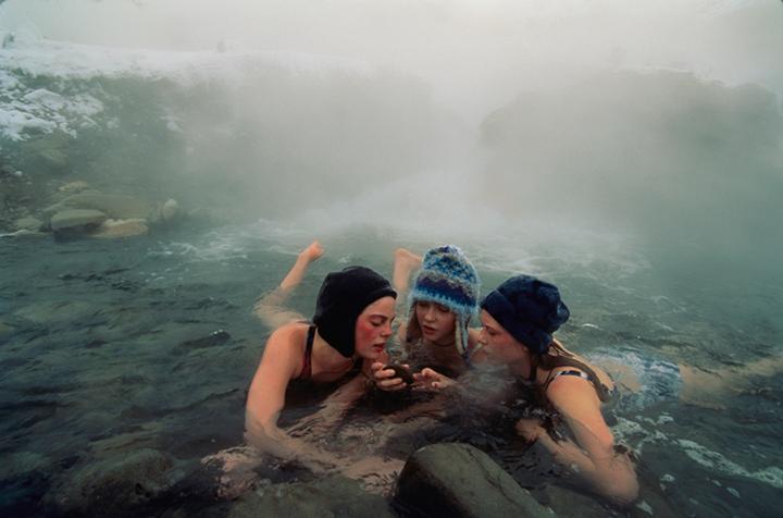 High school friends enjoy a thermal spring near Gardiner, Montana, April 1997