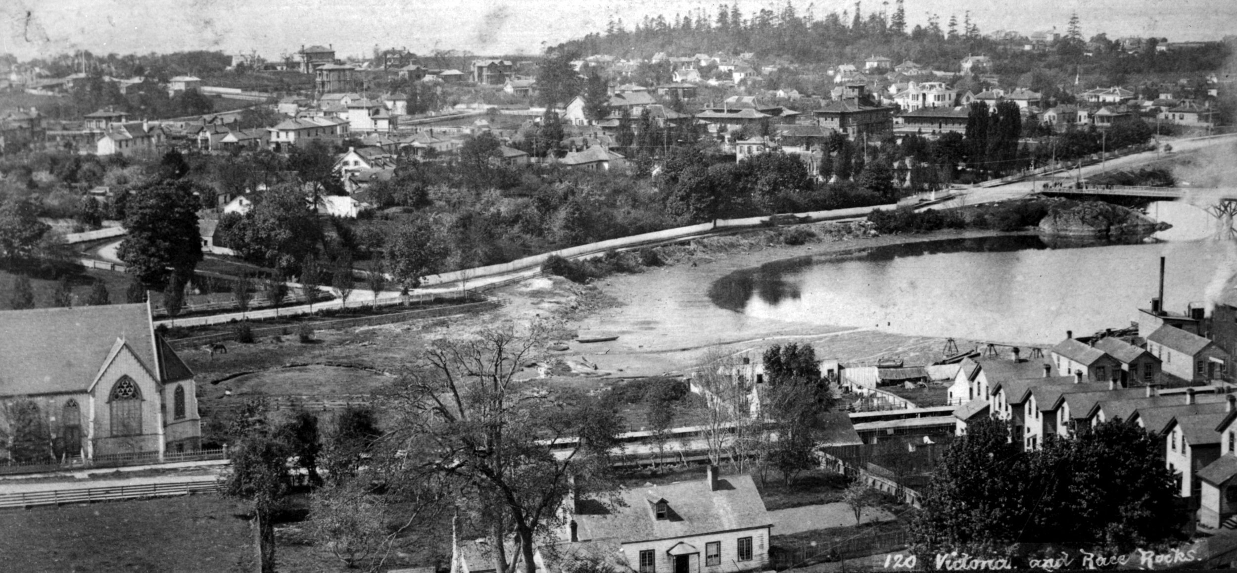 View of Victoria from Church Hill, looking southwest towards James Bay; Church of Our Lord at left, Birdcages across the James Bay mudflats. Image courtesy of the Royal B.C. Museum - B.C. Archives