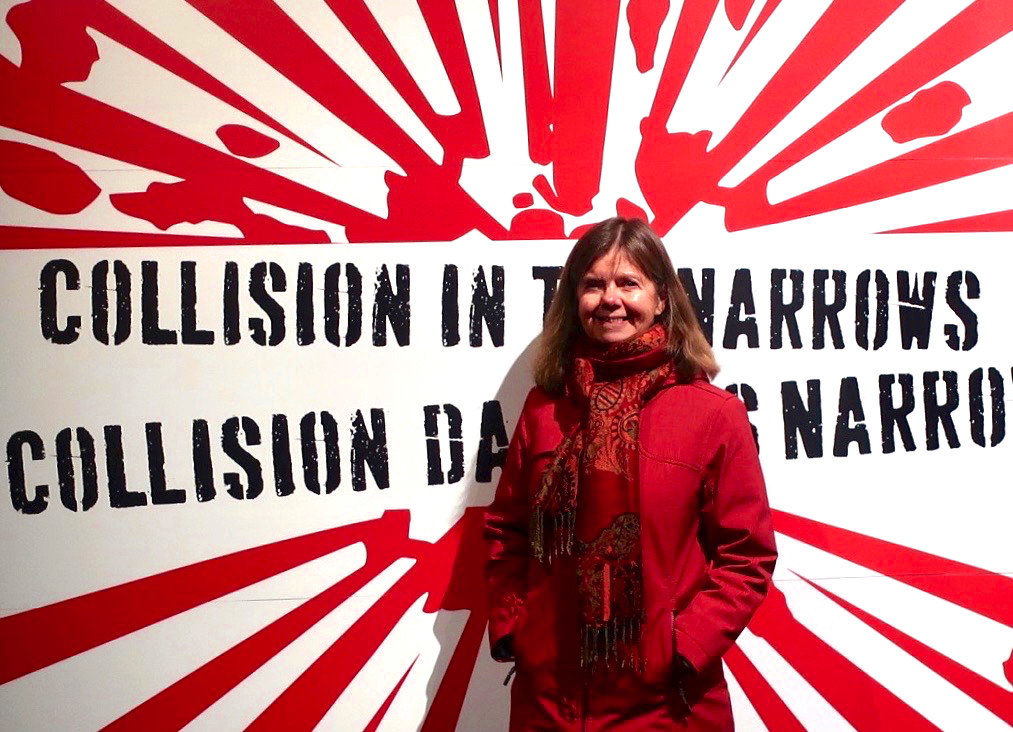 Author Julie Lawson standing in front of a sign commemorating the Halifax Explosion during her recent trip to Halifax. Photo by Partick Lawson.